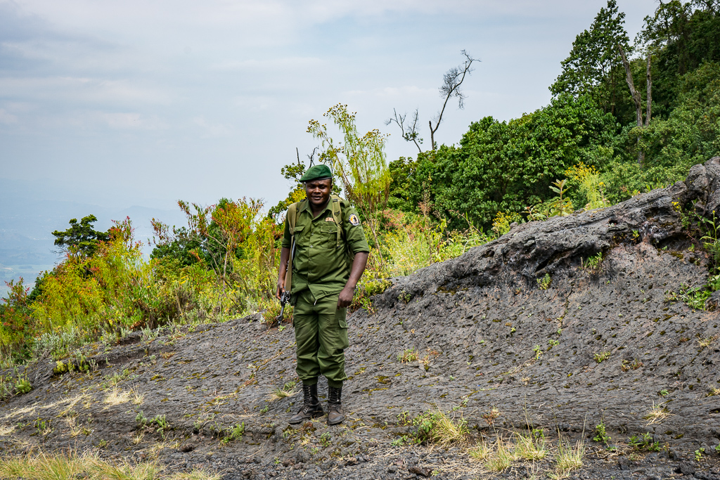 A guard, a Hike to the World's Largest Lava Lake - Mount Nyiragongo, DR Congo